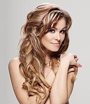 Eine Frau mit schönen langen Haaren - Haarverlängerungen, Hair Extensions, Echthaarsträhnen und -zöpfe gibts bei haarverlaengerungen-shop.de